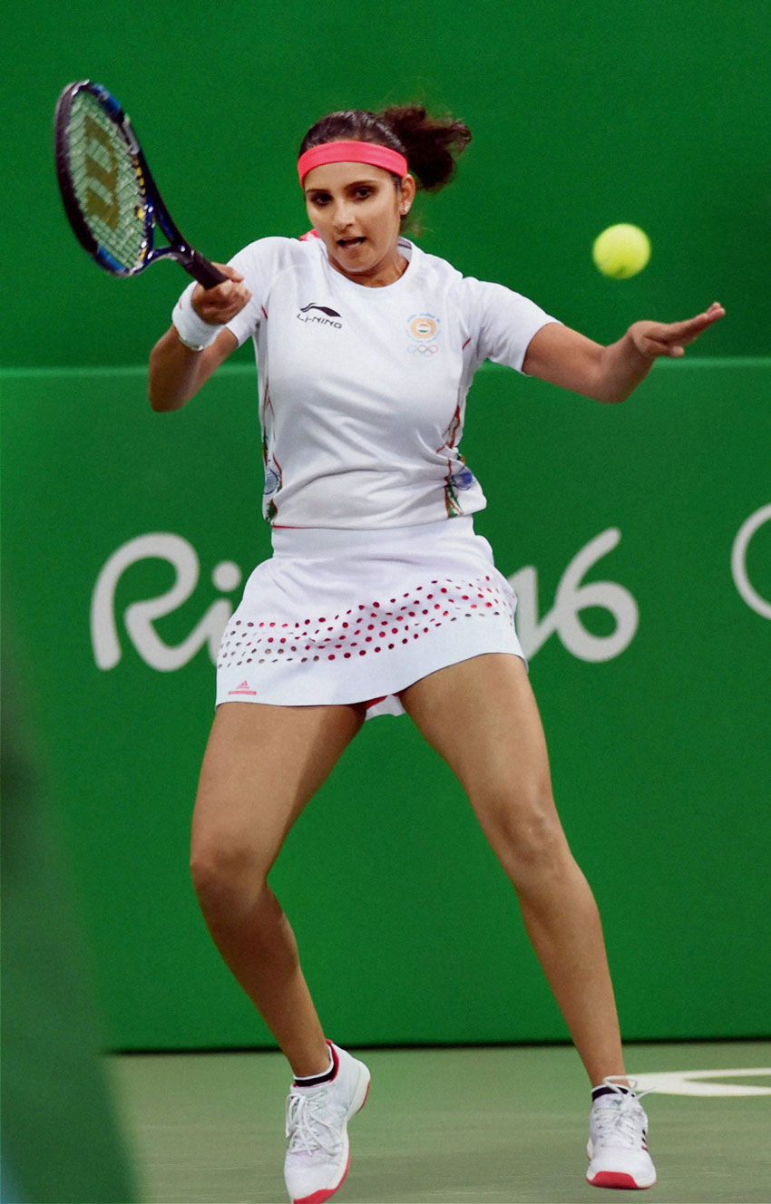 Sania Mirza plays a shot  against S. Stosur and J. Peers of Australia during the mixed doubles at 2016 Summer Olympics in Rio de Janeiro, Brazil, Aug. 11. (Atul Yadav | PTI)