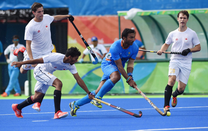 India and Canadian players in action during a men's field hockey match at Summer Olympics 2016 in Rio de Janeiro, Brazil, Aug. 12. (Atul Yadav | PTI)