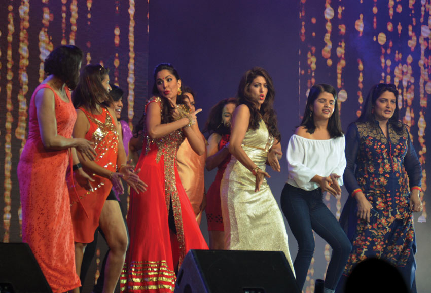 Katrina (4th from l) with fans on stage.