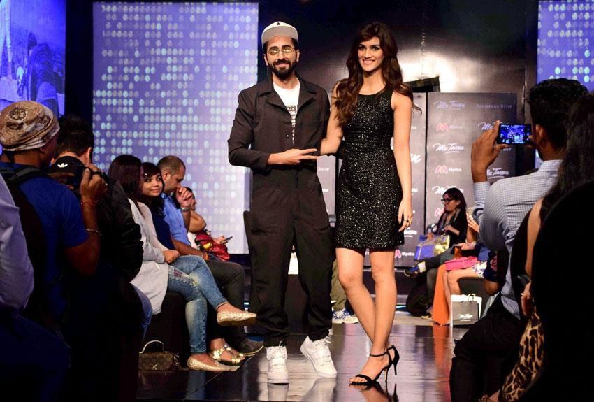 Ayushmann Khurrana and Kriti Sanon during a celebrity fashion show in Mumbai, Sept. 21. (Press Trust of India)