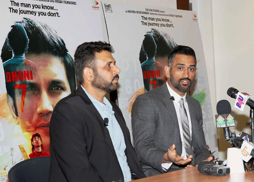 "Mahendra Singh Dhoni and producer of ""M.S. Dhoni: The Untold Story,"" Arun Pandey at a press conference in New York City, Sept. 15. (Press Trust of India)"