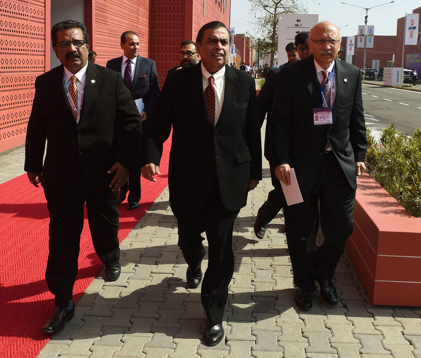 File photo of the Chairman and Managing Director of Reliance Industries Limited, Mukesh Ambani (c), as he arrives for the opening of the 'Make in India Week' in Mumbai, Feb. 13. (Punit Paranjpe/AFP/Getty Images)