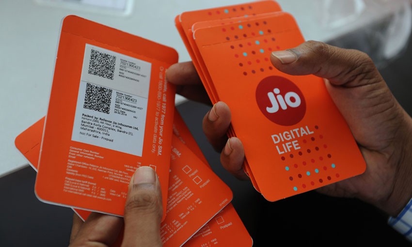 A customer selects his number of Reliance Jio Infocomm 4G mobile services in Mumbai on Sept. 6. India's richest man Mukesh Ambani launched his Reliance Industries' long-awaited 4G mobile services in September, sending shares of rival Bharti Airtel plummeting almost seven percent. (Indranil Mukherjee/AFP/Getty Images)