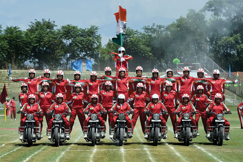 Female daredevils team of CRPF performs stunts during the celebration of 70th Independence day at Bakshi stadium in Srinagar, Aug. 15. (S. Irfan/PTI)