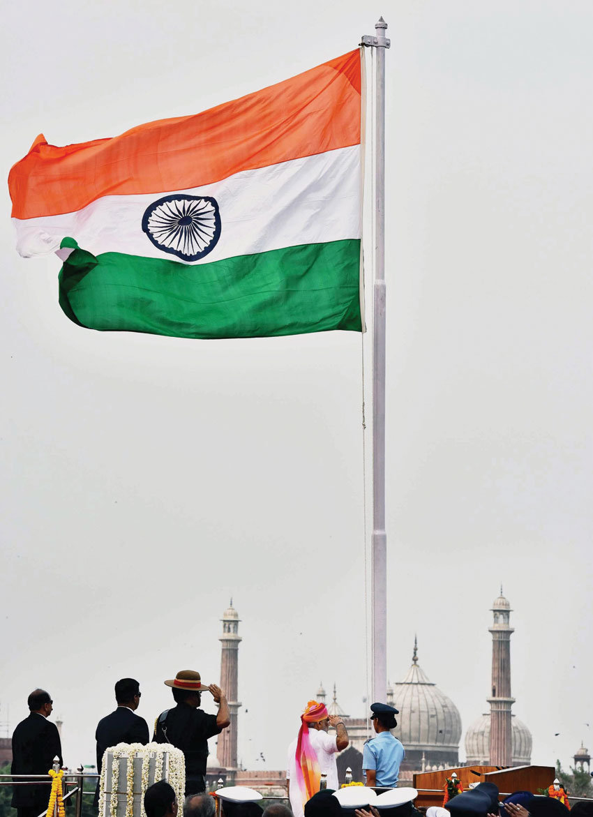 Prime Minister Narendra Modi saluting after unfurling the Tricolor flag at the ramparts of Red Fort, on the occasion of 70th Independence Day, in New Delhi, Aug. 15. (Press Trust of India)