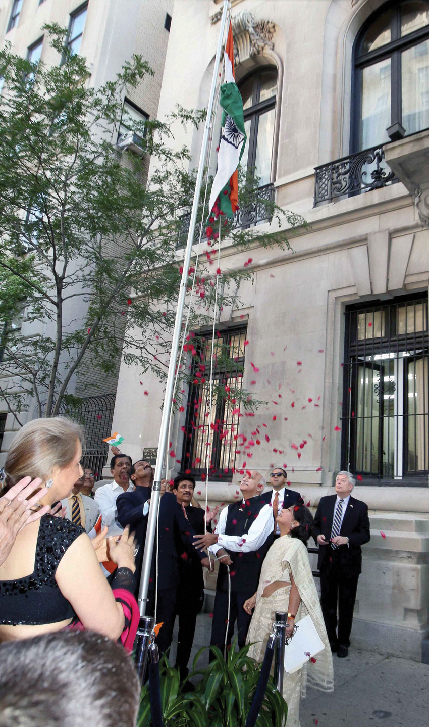 MOS External Affairs Minister M.J. Akbar hoists the Tricolor flag on the occasion of India's 70th Independence Day in New York, Aug. 15. (Press Trust of India)