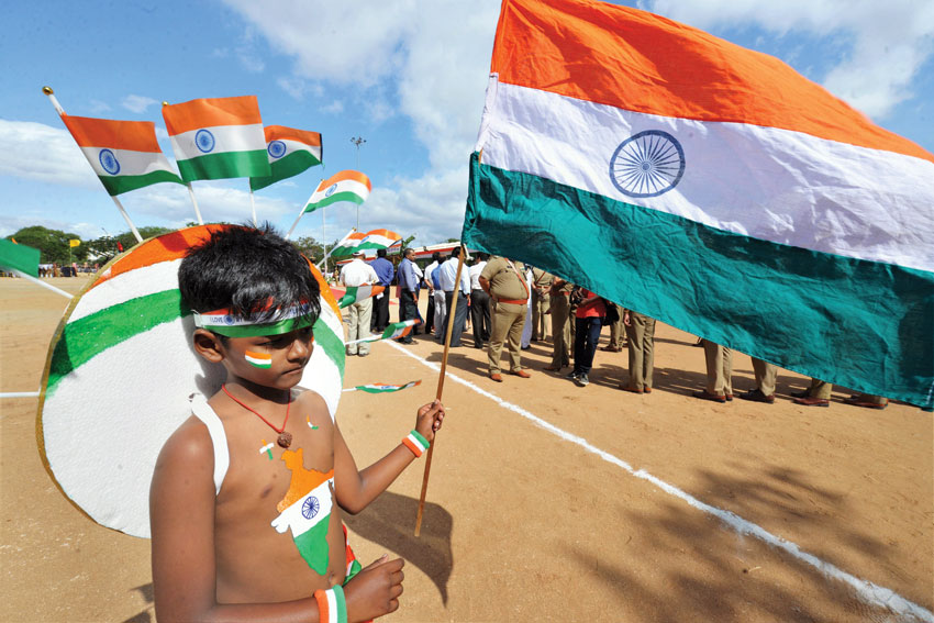 A boy carries Tricolors during an Independence Day function in Coimbatore, Aug. 15. (Press Trust of India)