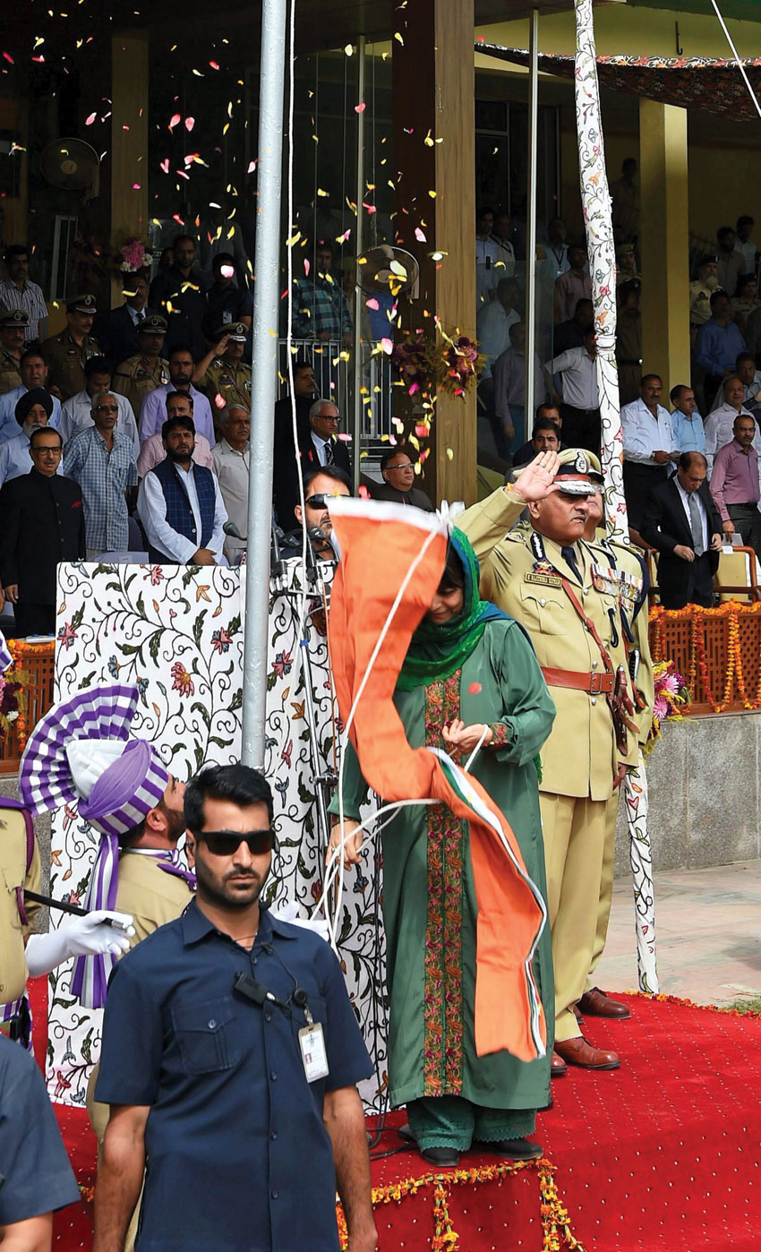 Jammu and Kashmir Chief Minister Mehbooba Mufti holding the National tricolor as it fell off the post during its unfurling at Bakshi stadium during the celebration of 70th Independence Day in Srinagar, Aug. 15. (S. Irfan/PTI)