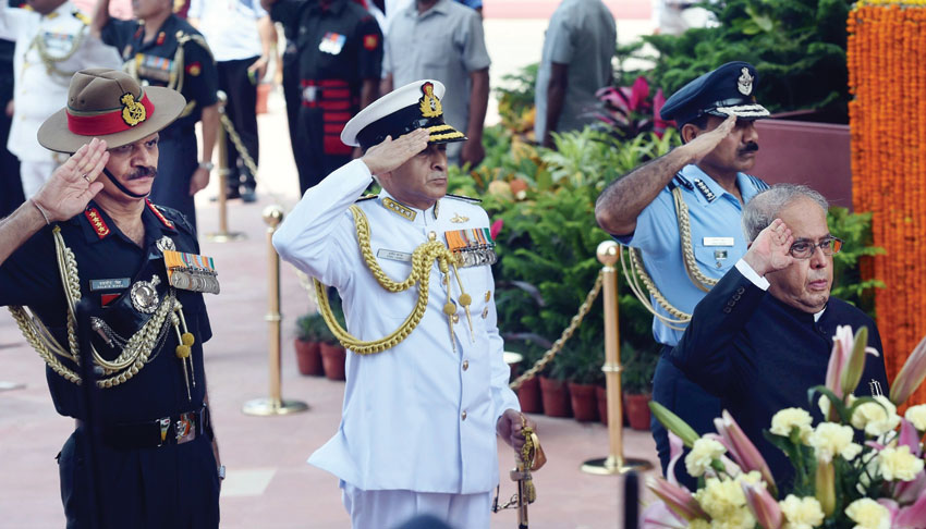 President Pranab Mukherjee paying homage at Amar Jawan Jyoti on 70th Independence Day in New Delhi, Aug. 15. Air Chief Marshal Arup Raha, Navy Chief Admiral Sunil Lanbal and Army Chief Gen. Dalbir Singh Suhag are also seen. (Manvender Vashist/PTI)