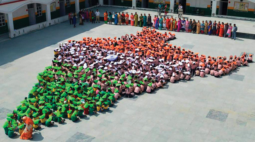 Students sit in formation to create India's map ahead of 70th Independence day celebrations in Jammu, Aug. 12. (Press Trust of India)