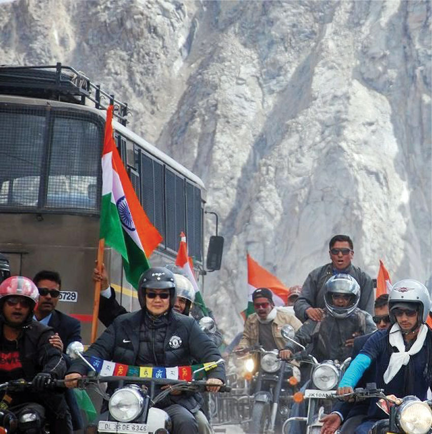 Minister of State Kiren Rijiju participates in the 'Tiranga Yatra' at Khardung La in Ladakh, Aug. 15. (Press Trust of India)