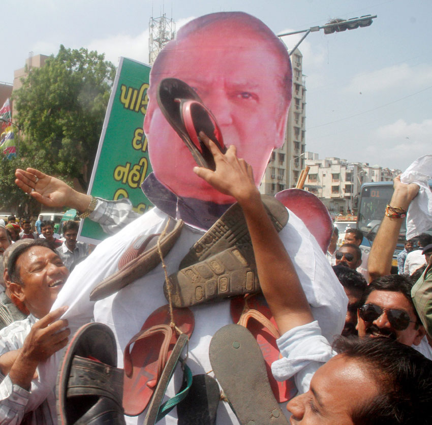 Muslims beating an effigy of Pakistan Prime Minister Nawaz Sharif during a protest against Uri attack, in Ahmedabad, Gujarat, Sept. 21. (Press Trust of India)