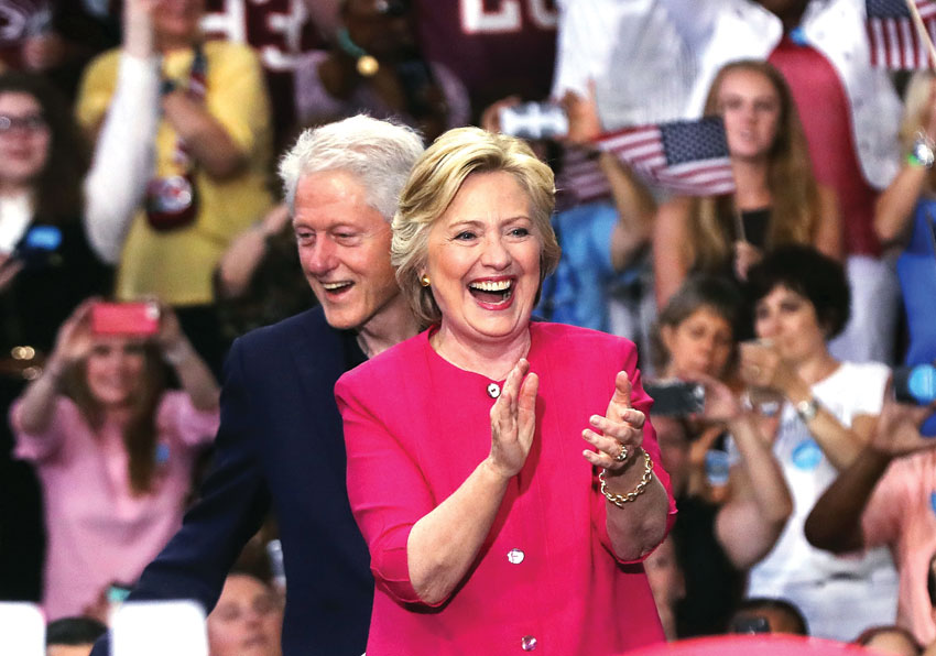 Democratic presidential candidate Hillary Clinton is joined by her husband former U.S. President Bill Clinton at a rally a day after accepting the Democratic Party's nomination for president at Temple University, July 29, in Philadelphia, Pennsylvania. (Spencer Platt/Getty Images)