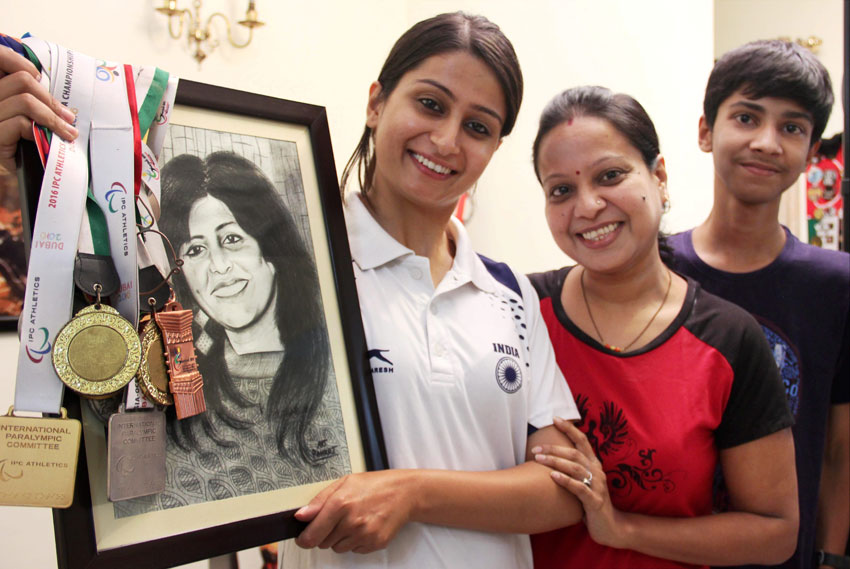 Family members of shotputter Deepa Malik celebrate at their residence in Gurgaon, Sept. 13. (Press Trust of India)