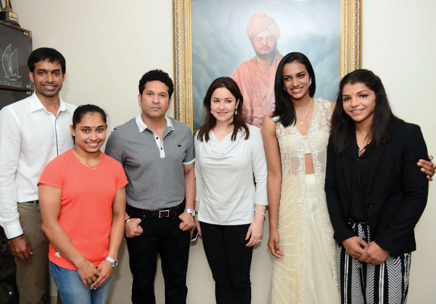 Cricket legend Sachin Tendulkar and his wife Anjali with Rio Olympics silver medalist shuttler P.V. Sindhu and bronze winner grappler Sakshi Malik, gymnast Dipa Karmakar, and badminton coach Pullela Gopichand at a felicitation function at Gopichand Academy in Hyderabad, Aug. 28. (Press Trust of India)