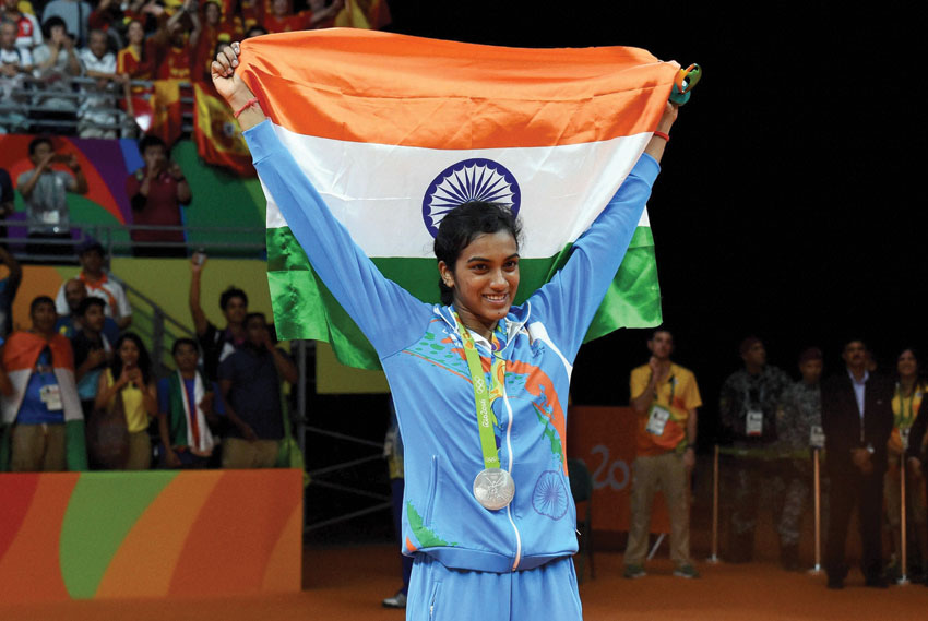 India's Pusarla V. Sindhu poses with the Indian Tricolor after winning silver medal in women's Singles final at the 2016 Summer Olympics in Rio de Janeiro, Brazil, Aug. 19. (Atul Yadav | PTI)