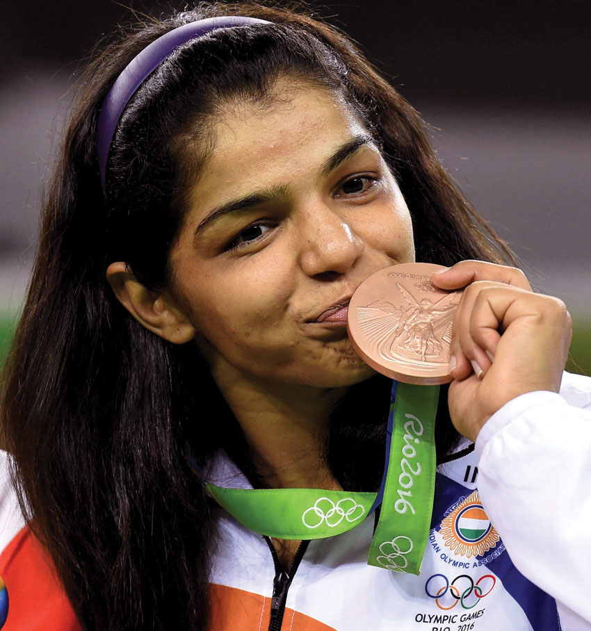 India's Sakshi Malik poses with her bronze medal for the women's wrestling freestyle 58-kg competition during the medals ceremony at the 2016 Summer Olympics in Rio de Janeiro, Brazil, Aug. 17. (Atul Yadav | PTI)