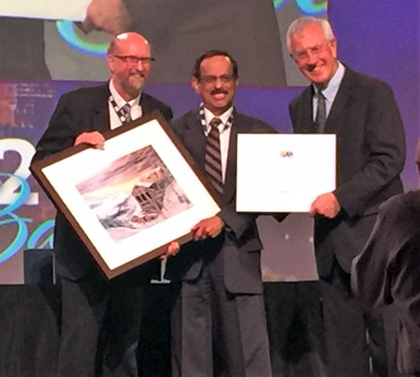 Prof. Somasundaran (c) receiving Life Time Achievement Award from the Chairman of the International Engineering Congress Prof. James Finch (l) and the Congress President Dr. Cyril O'Connor. (Courtesy: Thomas Abraham)