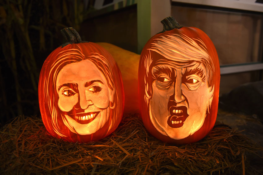 Styrofoam carvings on display while this year carving of 2016 Democratic nominee Hillary Clinton and Republican presidential nominee Donald Trump in pumpkin form  are being worked on by Pumpkin carver Hugh McMahon as he visits Chelsea Market in New York to complete his annual carving of a giant pumpkin, Oct. 28. (Timothy A. Clary/AFP/Getty Images)