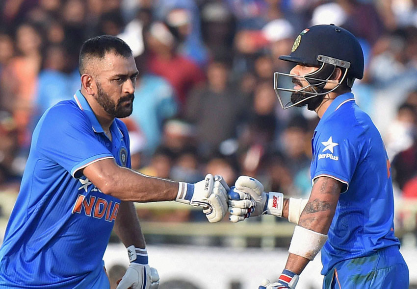 M.S. Dhoni congratulates  Virat Kohli on his half century.