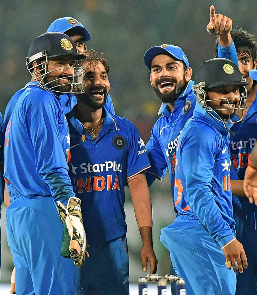 Indian Skipper M.S. Dhoni, Virat Kohli and Amit Mishra celebrate after their victory over New Zealand during the 5th ODI cricket match in Visakhapatnam, Oct. 29. (Ashok Bhaumik/PTI)