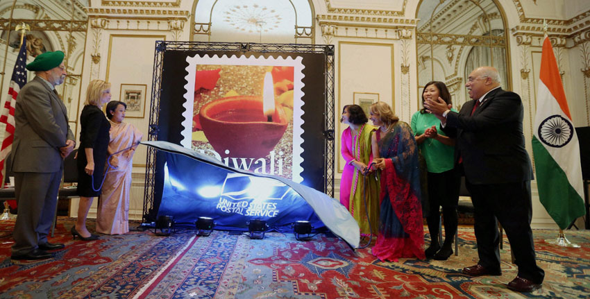 (L-r): Ambassador Hardeep Singh Puri, Congresswomen Maloney, NY Consulate General Riva Ganguly Das, Pritha Mehra, VP Mail Entry USPS, Ranju Batra Chair Stamp Committee, Congresswomen Meng and Ravi Batra at the release ceremony of Diwali Stamp at Indian Consulate, Oct. 5. (Press Trust of India)