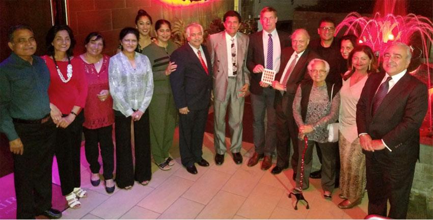 Some members of the Indian American community met with Congressman Swalwell, Oct. 6, at a dinner in Beverly Hills restaurant Spice Affairs. Photo shows (l-r): Manoj and Umi Mukerji, Nina Bawa, Vasu Pawar, Manju and NFIA president Ashok Madan, Rajendra Vora, Congressman Eric Swalwell and GOPIO Executive Trustee Inder Singh holding Diwali stamps, Deepi Singh, Spice Affair owners Dr. Punit and Sonia Chandak, Nicky Kapadia and Bob Bawa. (Photo courtesy: Inder Singh)