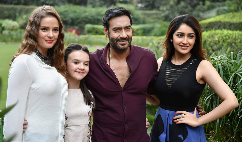 "Ajay Devgn (2nd from r) along with actress Sayesha Saigal (r), Erika Kaaras Olga (l), and British child artist Abigail Eames poses during promotion of his film ""Shivaay"" in New Delhi, Oct. 25. (Atul Yadav/PTI)"
