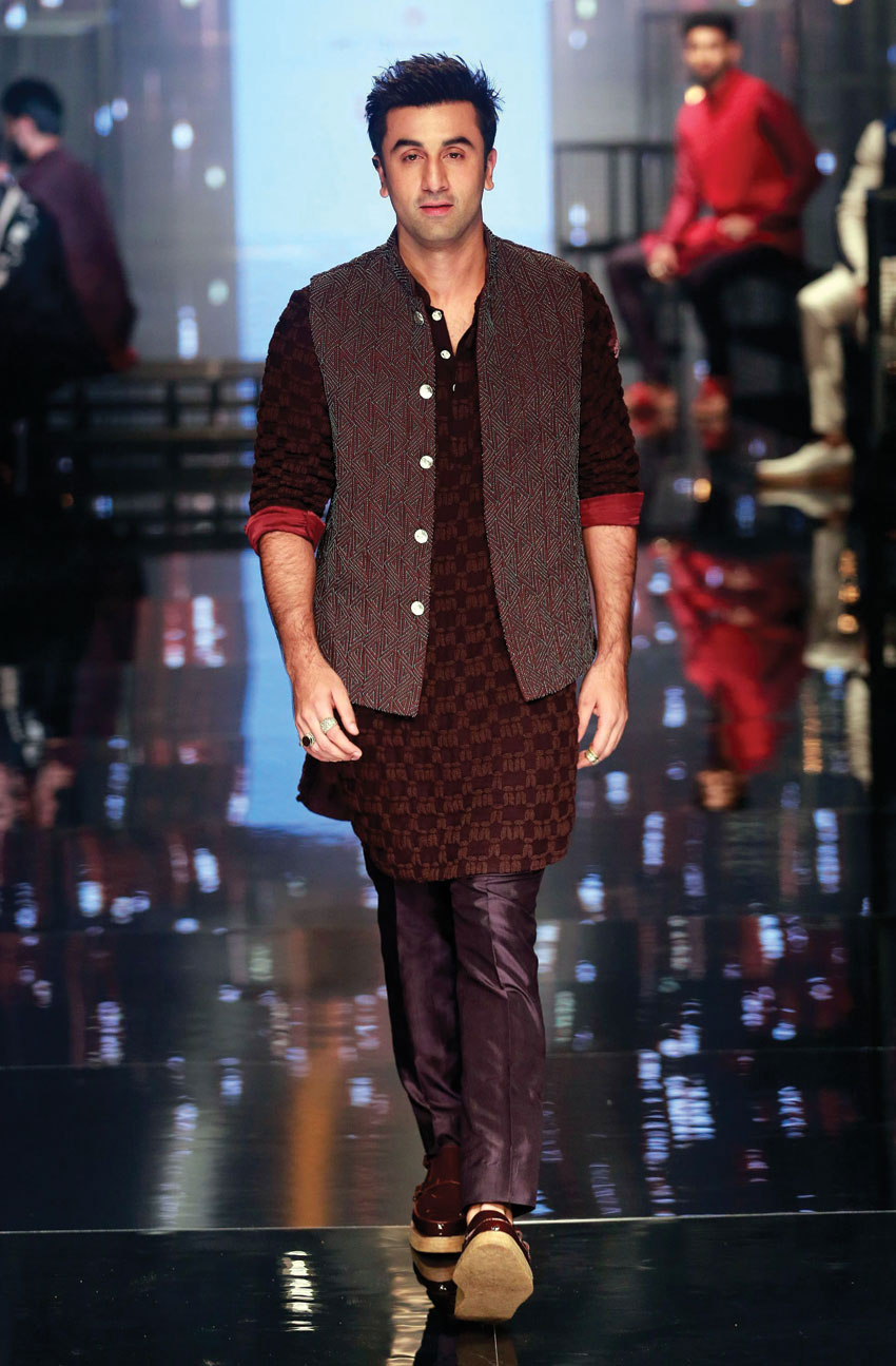 Ranbir Kapoor displays creations by Kunal Rawal during the Lakmé Fashion Week in Mumbai, Aug. 28.   (Press Trust of India)