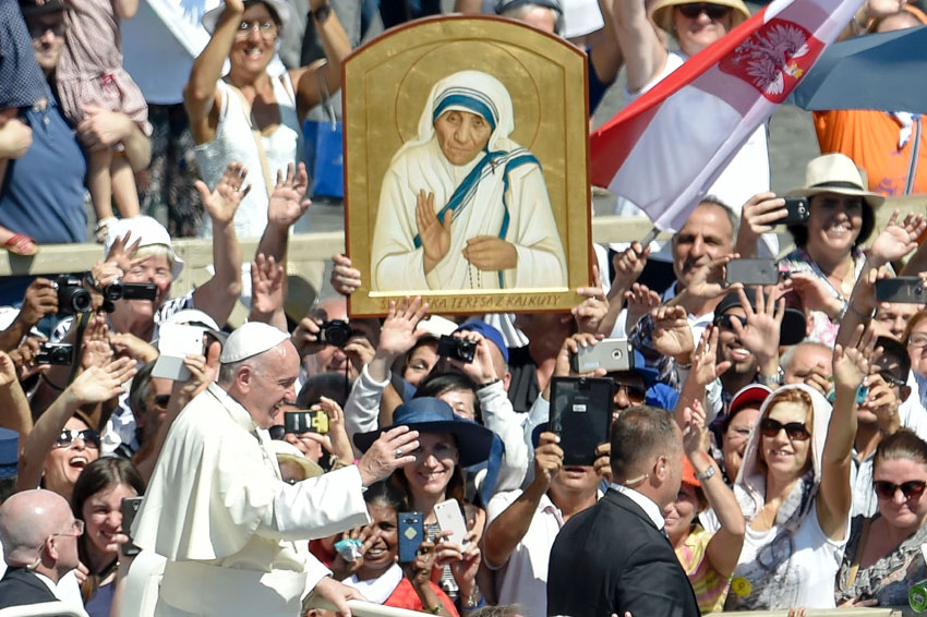 Pope Francis (l) waves to faithful as he leaves after a Holy Mass and the canonization of Mother Teresa of Kolkata, on Saint Peter Square in the Vatican, Sept. 4. Mother Teresa was made a saint on Sept. 4. Her elevation to Roman Catholicism's celestial pantheon came in a canonization mass in St Peter's Square in the Vatican that was presided over by Pope Francis in the presence of 100,000 pilgrims. (Andreas Solaro/AFP/Getty Images)