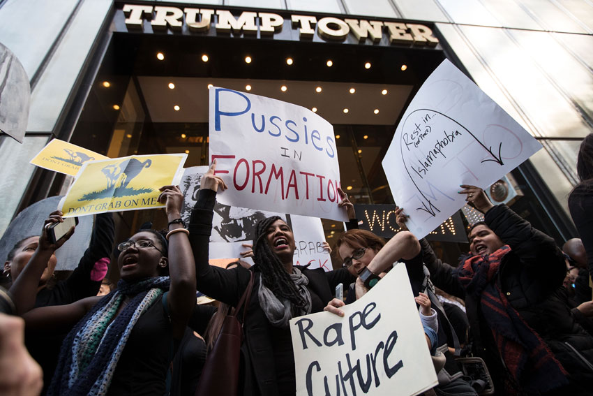 A group of protestors, comprised mostly of women, rally against Republican presidential candidate Donald Trump outside of Trump Tower, Nov. 3, in New York City. (Drew Angerer/Getty Images)