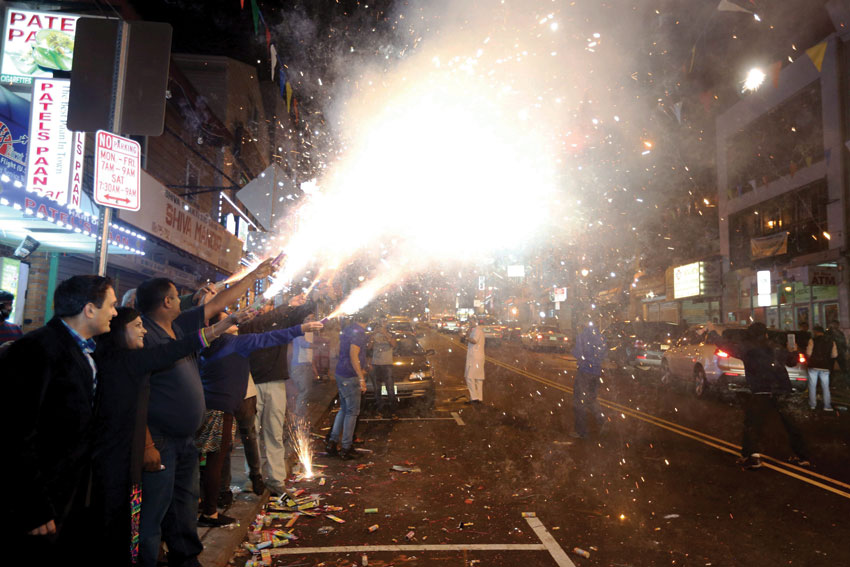 In sharp contrast to the rhetoric about lighting of firecrackers causing air pollution in parts of north India, Indian Americans burning firecrackers during Diwali celebrations in Jersey City, Oct. 31. No prior permission was taken for fireworks but the city police cooperated. (Press Trust of India)