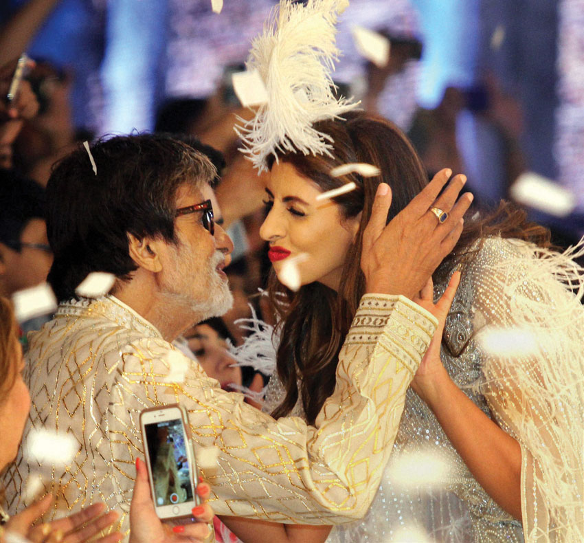 Amitabh Bachchan hugs his daughter Shweta Bachchan Nanda  during the launch of new international line by fashion designers Abu Jani and Sandeep Khosla in Mumbai, Nov. 4. (Press Trust of India)