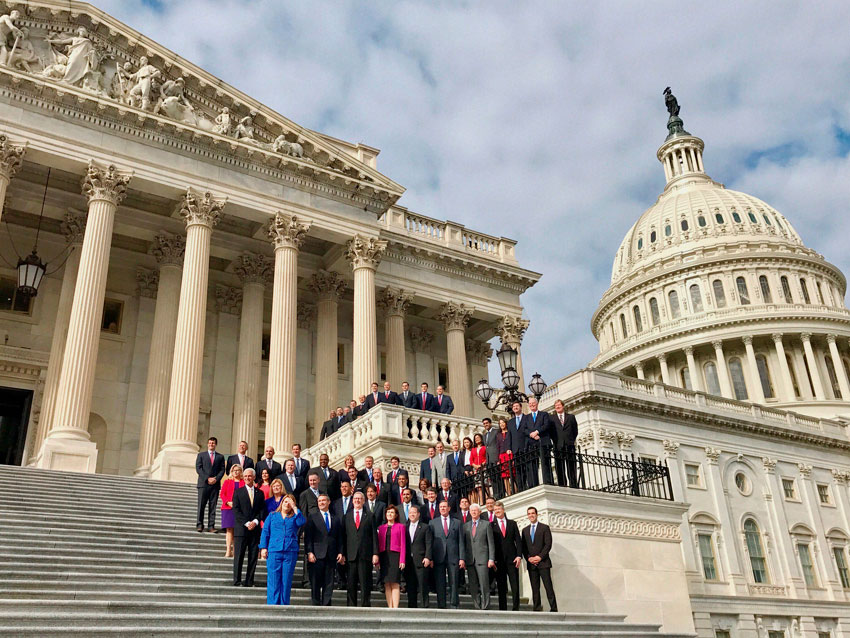 First-time elected members of U.S. House of Representative pose for a group picture at the U.S. Capitol in Washington, D.C., Nov. 15. They are here undergoing an orientation course. Congresswoman Pramila Jayapal (2nd row, in red jacket) is also seen, standing next to Congressman Ro Khanna from SF Bay Area. (Press Trust of India)