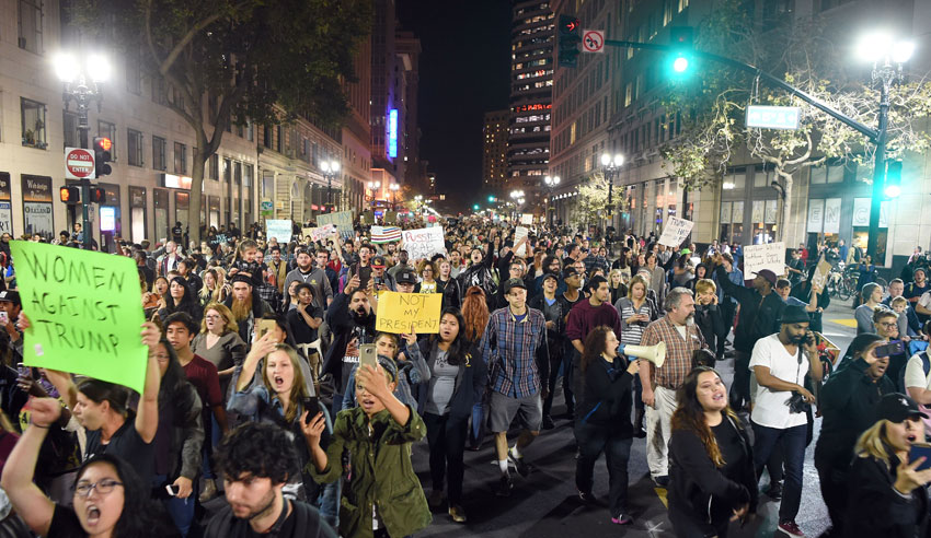 People march and shout during an anti-Trump protest in Oakland, Calif., Nov. 9. (Josh Edelson/AFP/Getty Images)
