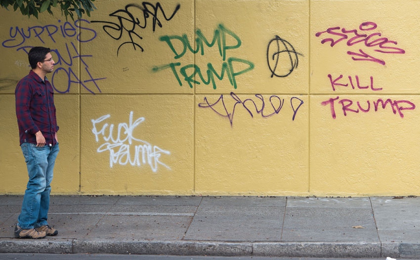 A man looks at graffiti against President-elect Donald Trump in downtown Oakland, Calif., Nov. 11. There have been widespread violent protests against Trump's election. (Josh Edelson/AFP/Getty Images)