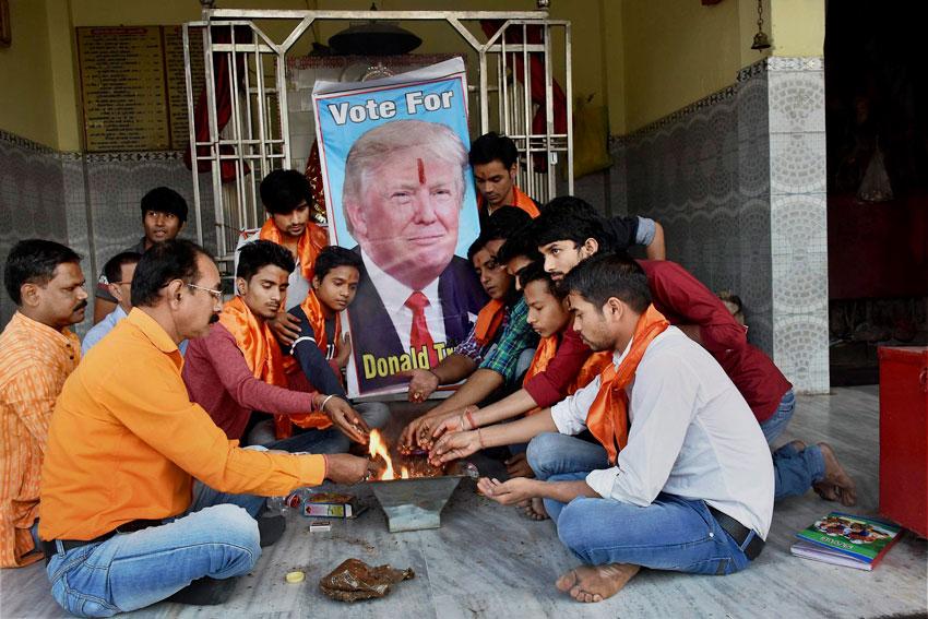 "Akhil Bharatiya Hindu Mahasabha members performing ""havan"" for the victory of U.S. presidential candidate Donald Trump at a temple in Patna, Nov. 8. (Press Trust of India)"