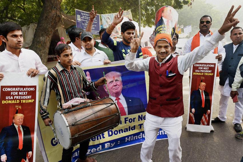 Activists of Hindu Sena celebrate victory of U.S. Republican Presidential candidate Donald Trump in the U.S. Presidential elections, in New Delhi, Nov. 9. (Subhav Shukla/PTI)