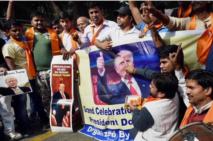Hindu Sena activists celebrate victory of U.S. Republican Presidential candidate Donald Trump, in New Delhi, Nov. 9. (Subhav Shukla/PTI)