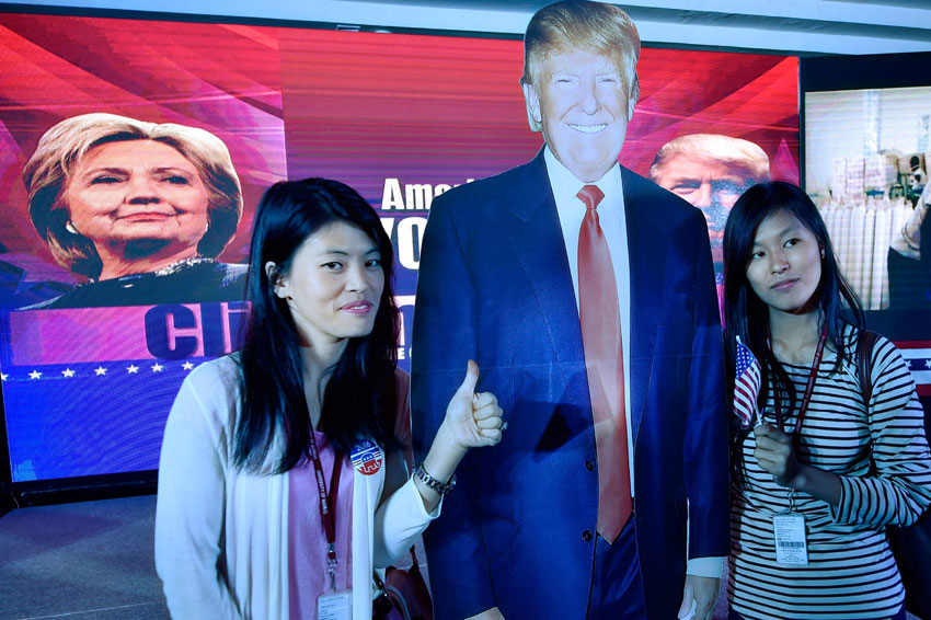 Students of a private college taking a selfie with the cut-outs of Donald Trump after he was elected as the next President at a function in Chennai, India, Nov. 9. (Press Trust of India)