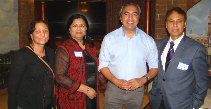 Congressman Ami Bera (2nd from r) with event organizers and friend. (Ras H. Siddiqui)