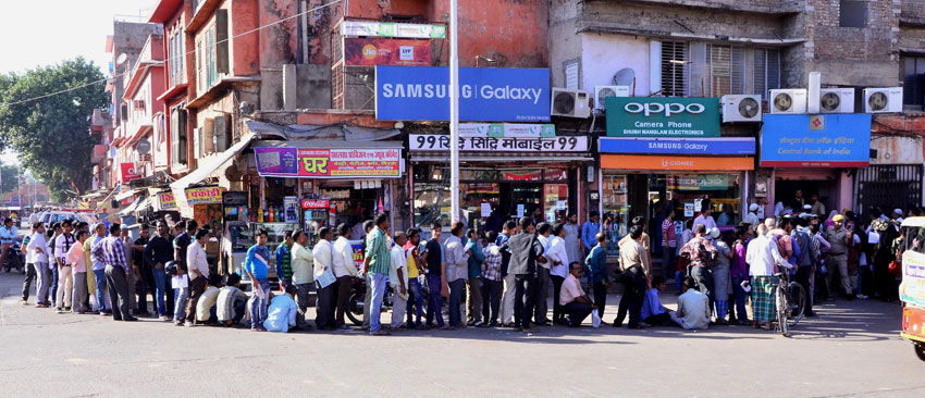People line up outside a bank to exchange their old Rs. 500 and Rs. 1,000 notes in Jaipur, Rajasthan, Nov. 10. (Press Trust of India)