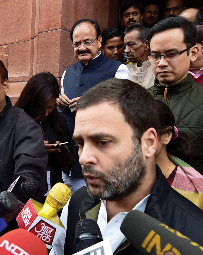 Congress Vice President Rahul Gandhi talks to the media at Parliament in New Delhi, Nov. 30. Indian Information & Broadcasting Minister M. Venkaiah Naidu is also seen (l). (Kamal Singh/PTI)