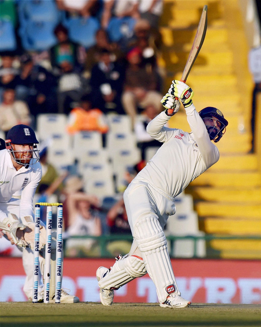 India's Ravindra Jadeja hits a six during the 2nd day of 3rd India-England test match in Mohali, Nov. 27. (Vijay Verma/PTI)