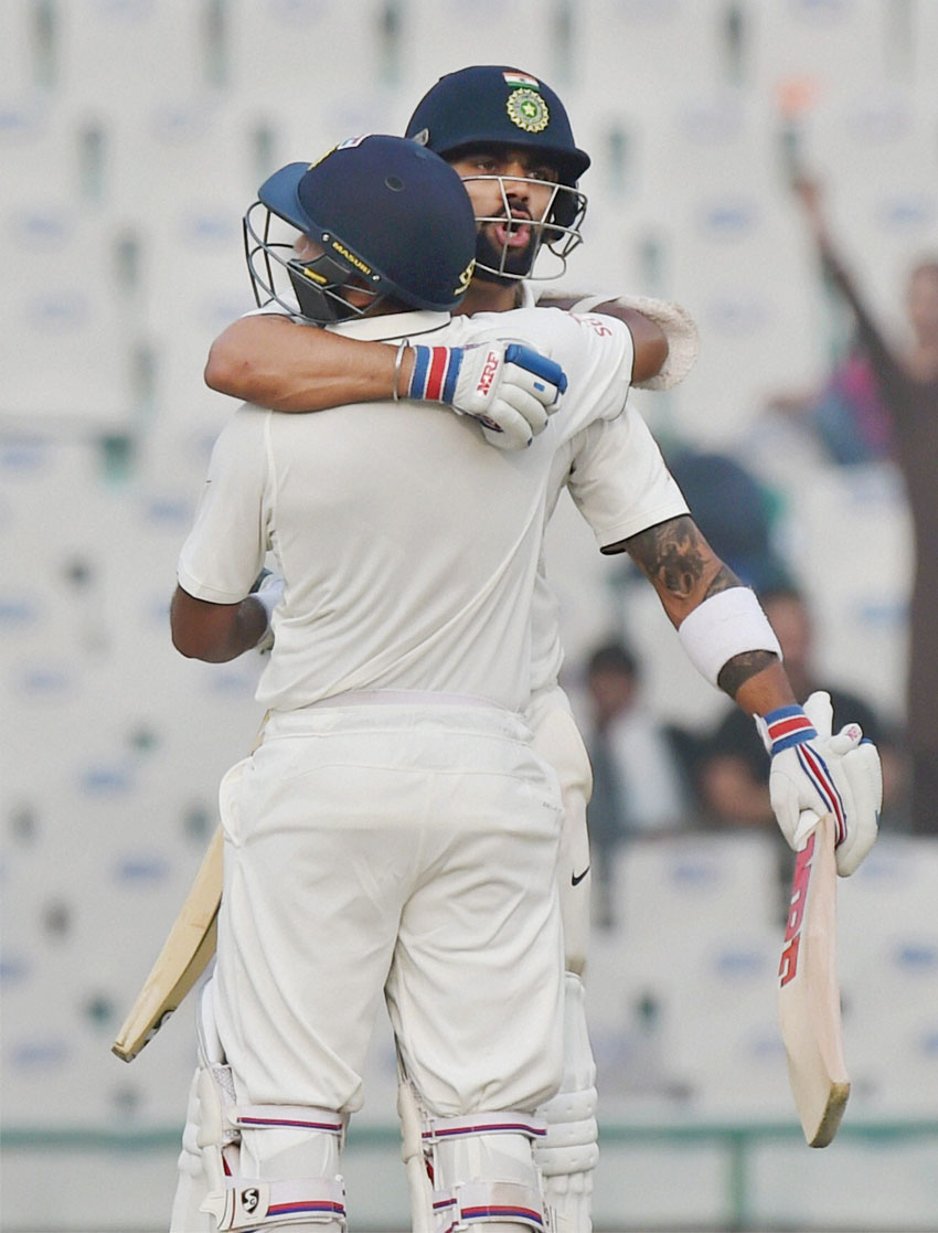 Indian captain Virat Kohli celebrates along with Parthiv Patel after winning the third Test match between India and England in Mohali, Nov. 29. (Vijay Verma/PTI)