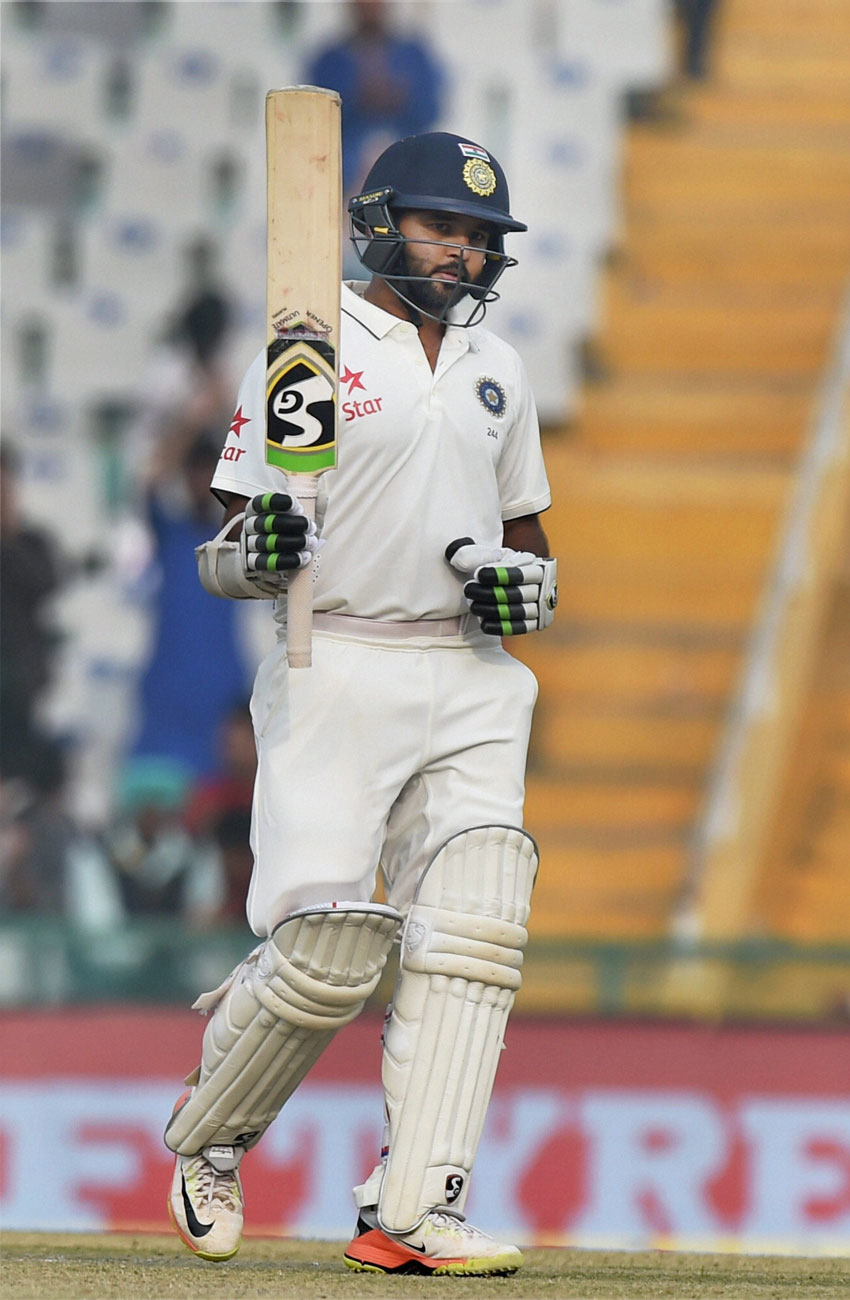 Indian batsman Parthiv Patel celebrates after completing a half-century on the fourth day of the third Test match between India and England in Mohali, Nov. 29. (Vijay Verma/PTI)