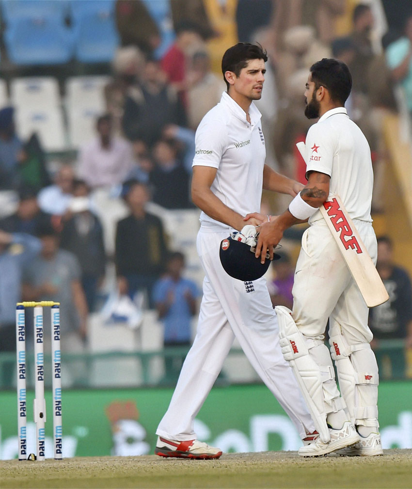 Indian captain Virat Kohli greets England captain Alastair Cook after India won the third Test match against England in Mohali, Nov. 29. (Vijay Verma/PTI)