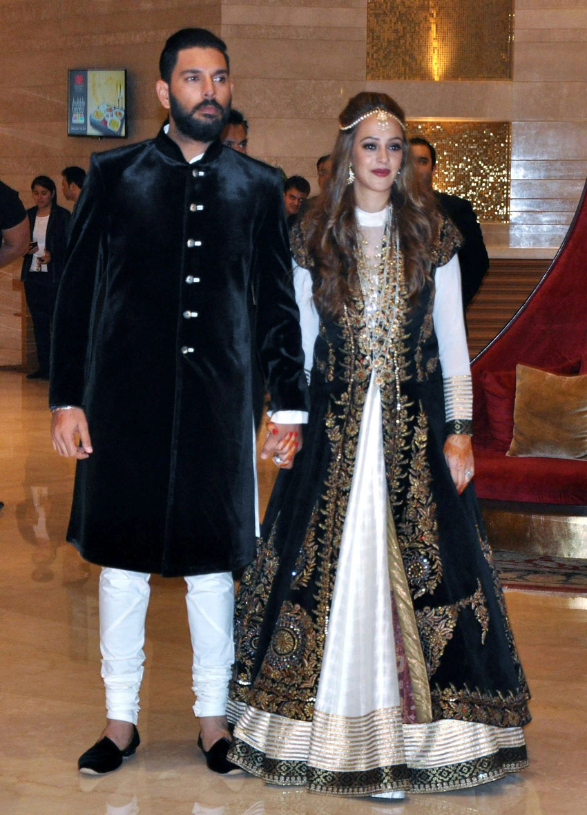 Cricketer Yuvraj Singh with Hazel Keech during their Ring Ceremony at a hotel in Chandigarh, Nov. 29. (Press Trust of India)